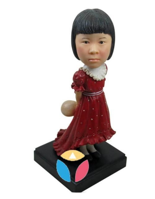 Teenage girl in nice dress bobblehead doll