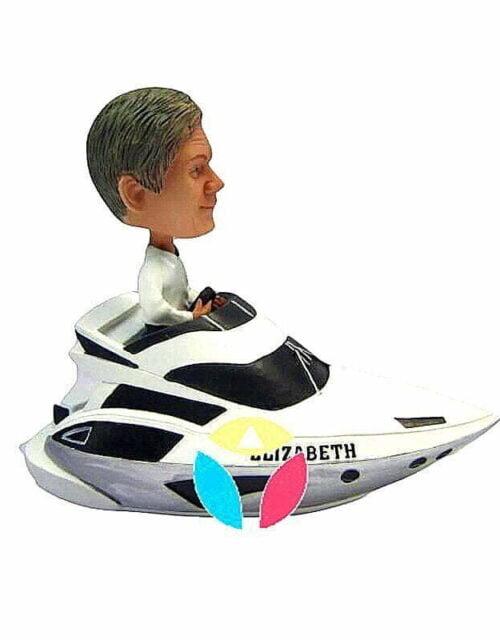 Unique Bobble Head Male Driving A Speedboat
